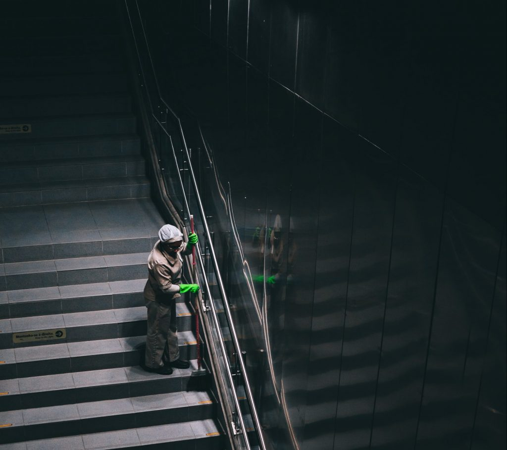 person-sweeping-the-stairs